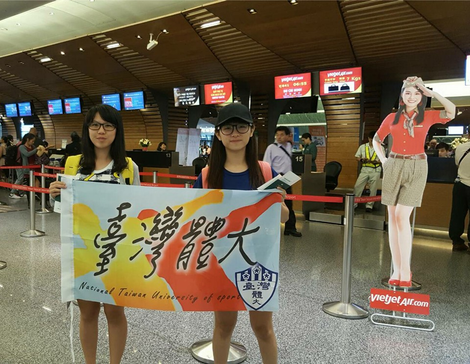 Taiwanese college students taking a photo at the airport