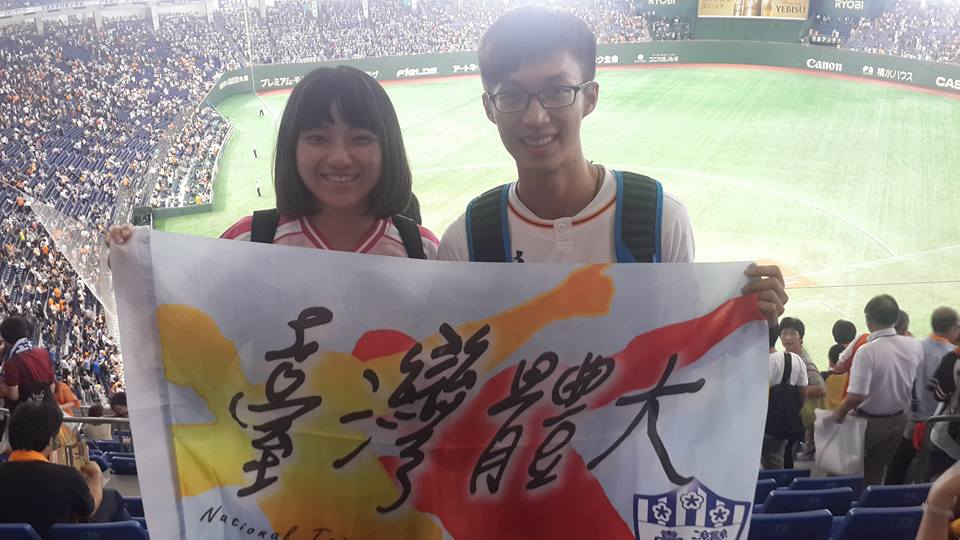 Taiwanese college students posing at the side of the stadium